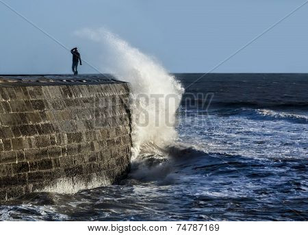 Huge Wave Breaks Over The Cobb