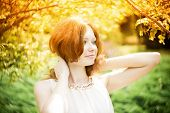 image of freckle face  - Portrait of redhead girl with blue eyes on nature - JPG