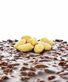 picture of confectioners  - Peanuts on a chocolate waffle cake on a white background with space for text - JPG