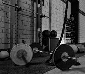 stock photo of cross  - Barbells in a gym bar bells and rope at cross fit - JPG