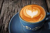 pic of latte  - cup of coffee latte art in the coffee shop vintage color - JPG
