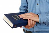 stock photo of bible verses  - Man holding Bible isolated on white - JPG