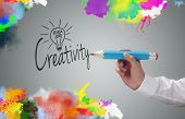 pic of creativity  - Businessman writing the word creativity and painting abstract colorful design on gray background concept for business idea - JPG