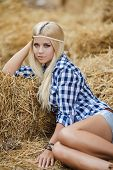 pic of shepherdess  - Sexy fashion woman in cow girl country style on hay stack - JPG
