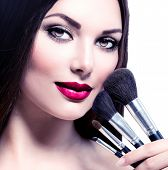 image of makeover  - Beauty Woman with Makeup Brushes - JPG