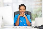 picture of nurse practitioner  - beautiful female african american medical nurse with stethoscope - JPG