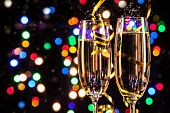 pic of color spot black white  - Glasses of champagne on black background with blur colored spot lights - JPG