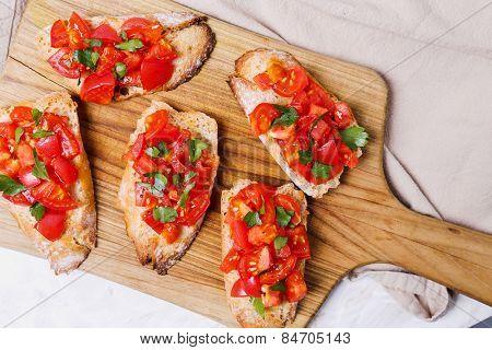 Delicious bruschetta on the board