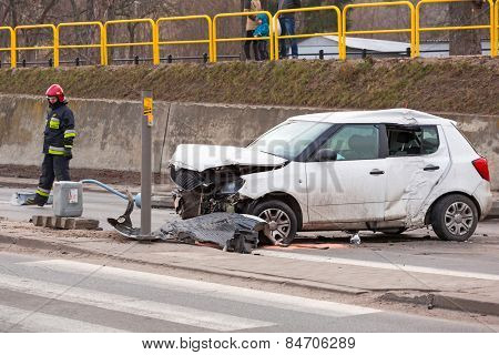 GDANSK, POLAND - FEBRUARY 21, 2015: The scene of a car crash on the road of Gdansk, Poland. Fire fighters and Police helping with a car traffic.