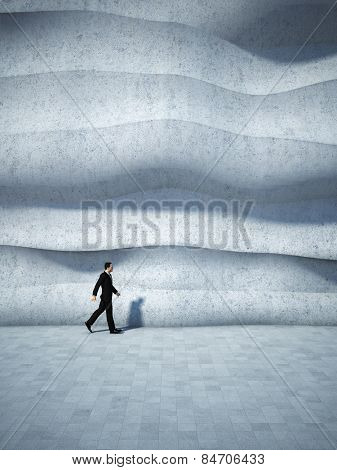 Concept of businessman walking along the abstract design wall. 3D render.