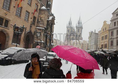 PRAGUE, CZECH REPUBLIC - FEBRUARY 23, 2013: Heavy snowfall covering the Tyn Church on Old Town Square in Prague, Czech Republic.