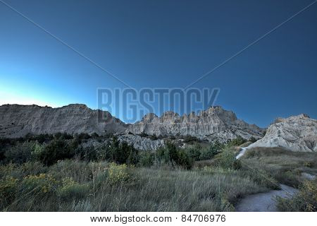Sundown Behind Rugged Mountains In The Badlands