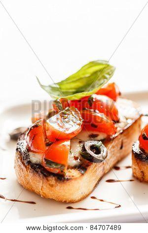 Bruschetta with tomato, mozarella and basil
