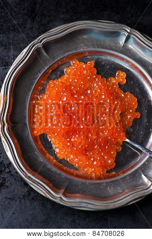 Salmon Caviar On Metal Plate Over Dark Background