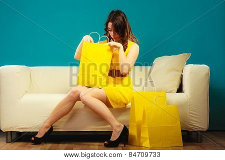 Girl With Shopping Bags On Couch
