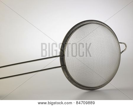 kitchen ware sieve on the white background