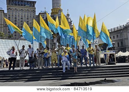 Group of activists with yellow-blue flags