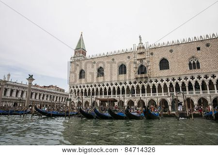 Gondolas Parking Near Doges Palace In Summer Venice