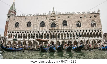 Gondolas Pier Near Doges Palace In Summer Venice