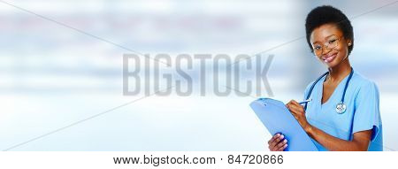 Medical african american doctor  woman over blue background.