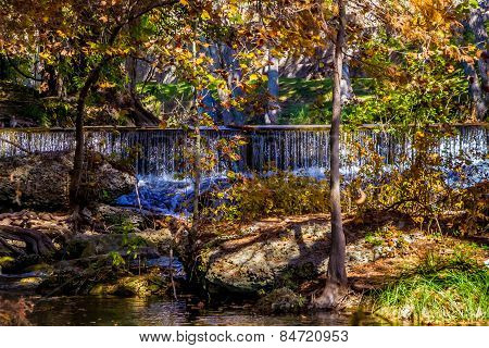 Picturesque Waterfall with Stunning Fall Foliage in Texas.
