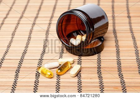 Multivitamin Pills In A Brown Medicine Jar