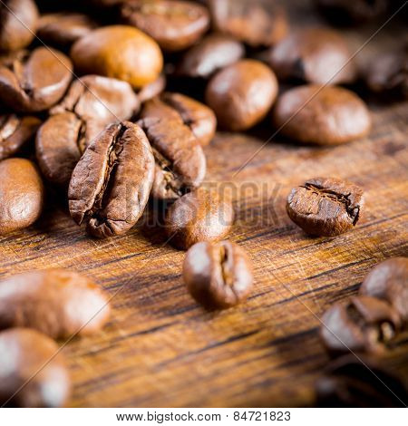 coffee beans closeup on wooden background