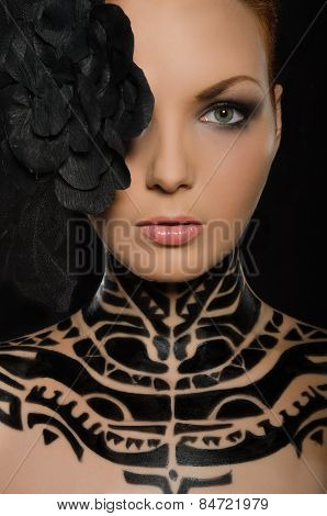 Portrait Of Woman With Flower And Black Body Art