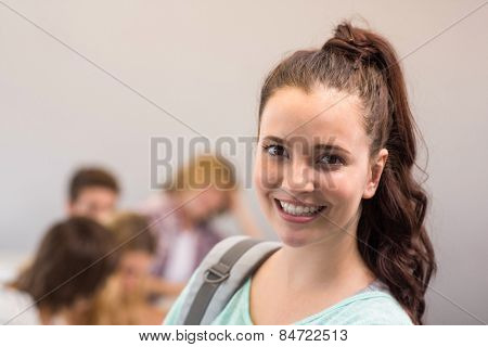 Close up portrait of smiling female student in classroom
