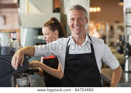 Barista smiling at the camera at the cafe