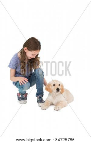 Crouching little girl next dog on white background