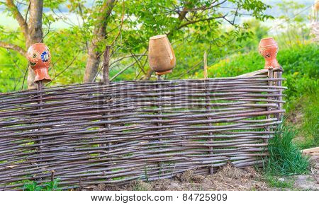 Traditional ukrainian fence with clay pots