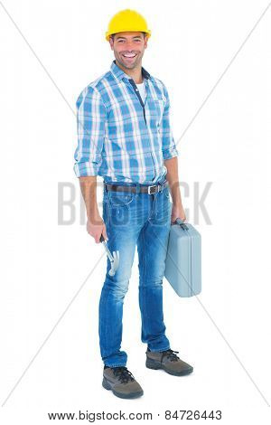 Full length portrait of manual worker with hammer and toolbox on white background