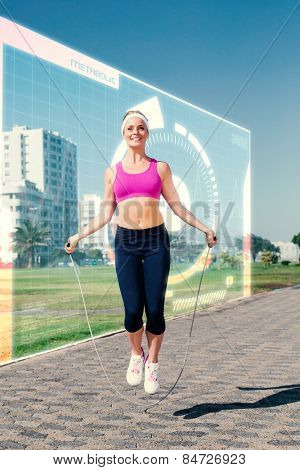Fit blonde skipping rope on the pier against fitness interface