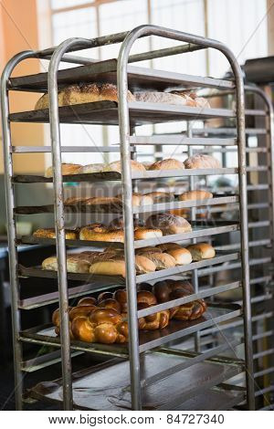 Catering building with shelf of hot breads in the kitchen of the bakery