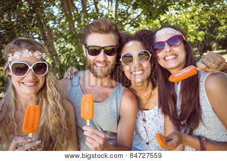 Hipster friends enjoying ice lollies on a summers day