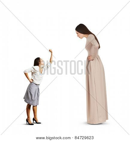 small woman screaming and showing fist to big serious woman over white background