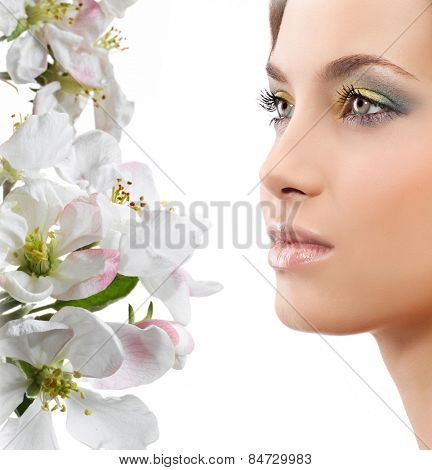 beauty young caucasian attractive woman portrait isolated on white background spring flowers face skin makeup eyes lips closeup studio shot