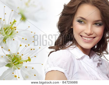 closeup portrait of attractive  caucasian smiling woman brunette isolated on white studio shot lips toothy smile face hair head and shoulders  tooth spring flowers