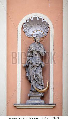 GRAZ, AUSTRIA - JANUARY 10, 2015: Virgin Mary on the portal of Dreifaltigkeitskirche ( Holy Trinity ) church in Graz, Styria, Austria on January 10, 2015.