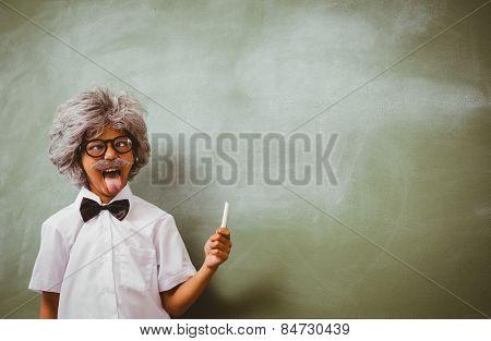 Portrait of little boy dressed as senior teacher in front of blackboard