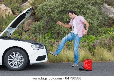 Angry man after a car breakdown at the side of the road
