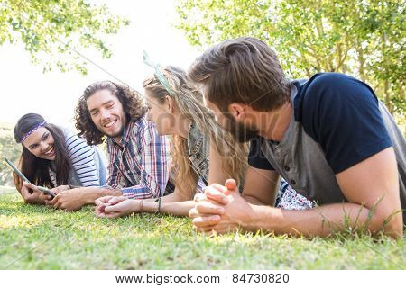 Classmates revising together on campus on a summers day