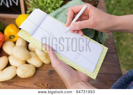 Woman checking her shopping list on a sunny day