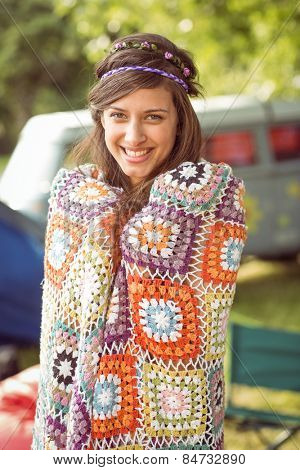 Pretty hipster wrapped in crotchet blanket at a music festival