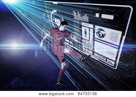 Football player in yellow kicking against abstract technology background