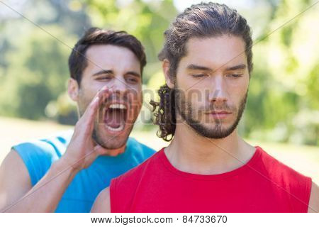 Tough trainer shouting at his client on a sunny day