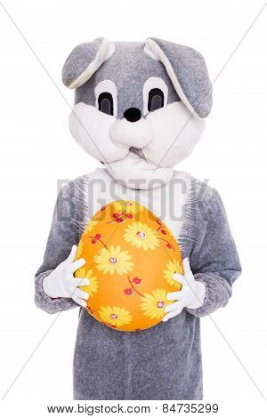Big plush bunny hold Easter egg