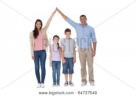 Portrait of happy parents joining hands above children against white background