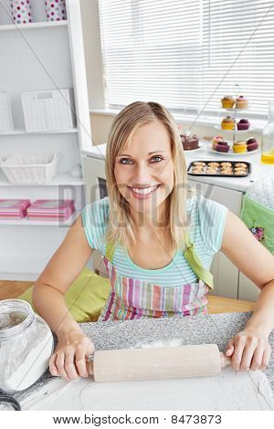 Cheerful Woman Baking In The Kitchen
